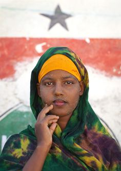 Teenage girl wearing Qasil (which comes from a tree and is used as a protection from the sun) on her face -  Berbera, Woqooyi Galbeed, Somalia