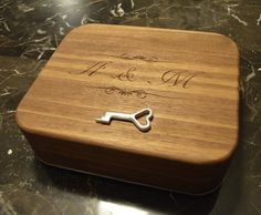 This is a mechanical iris lock box that I made on my Shapeoko for my fiancee's ring (Yes, turns out you can use your cnc to get engaged).  It consists of two gears, key and lock, LEDs with hidden switch and batteries to illuminate ring when opened, solid walnut box, 22 walnut inlays and of course the iris mechanism. Each joint uses 3mm ID micro bearings so the operation is very smooth.  Raw Materials:  Walnut - home depot  Aluminum (6061) - amazon/ebay  Purchased Products:  M3 bolts  3mm...