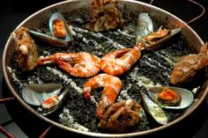 Arroz Negra: Cova's squid-ink paella topped with shrimp, soft-shell crabs and mussels.