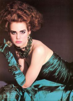Sandra Zatelazzo, according to an informant.  Everyone pooh-poohs Eighties fashion, but I think it was a fantastic time for evening, with the return of strapless gowns, gloves, jewel tones and fantastic glamour.