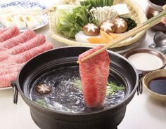 しゃぶしゃぶ Shabu-shabu - thinly sliced meat boiled quickly with vegetables, and dipped in sauce