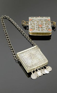 Morocco - Marrakech | Two Koran pendant holders; silver tone metal (possibly silver alloy) with pendant coins (dated 1320H / 1902 and 1299H / 1881) and a silver and copper one, with coral cabochons | Sold ~ (May '15)