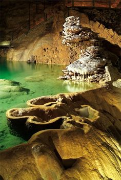 Padirac Cave, France.....this sounds so amazing.  Beautiful underground river,  you can boat through also.