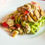 Grilled Lemon Herb Tofu with Mediterranean Relish over Avocado Pesto Fettuccine