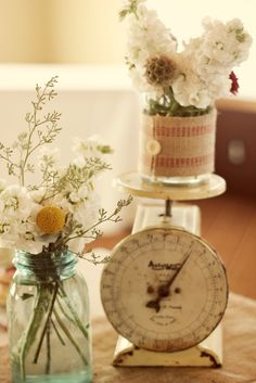 Whimsy wedding decor with vintage scale