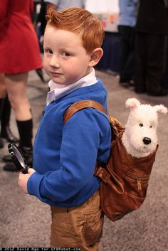 TINTIN | this boy's ginger hair gives him a leg up for his Halloween costume. Dog Snowy in the backpack, FTW!