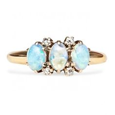Westby is a stunning antique Victorian ring featuring three oval opals set in 14K rose gold. Amazing! TrumpetandHorn.com | $825
