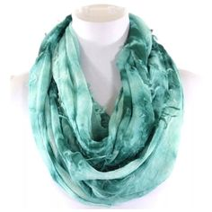 "B26 Textured Raw Edge Tie Dye Teal Infinity Scarf Tie Dye Infinity Scarf    ‼️ PRICE FIRM UNLESS BUNDLED WITH OTHER ITEMS FROM MY CLOSET ‼️   ABSOLUTELY FABULOUS!!!!  Textured tie dye fabric.  100% viscose.  Dress up any outfit day or night. Please check my closet for many more scarves and clothing items.  Length 35""  Width 20"" Boutique Accessories Scarves & Wraps"