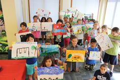 Monday, August 5 - Impressionist Painting Kids grades 3 & 4 created their own Impressionist paintings using dabs of color and cotton swabs. Do we see a future Monet, Renoir, Cezanne, or Manet?