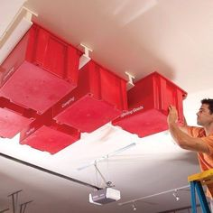 Build this simple, slide-in storage system for your garage. f your garage is running out of space, try building this overhead storage system. The construction is simple and fast, and the whole system is made with standard materials. Garage Ceiling Storage, Garage Storage Systems, Garage Organization, Organized Garage, Organization Ideas, Basement Storage, Organizing Tips, Workshop Organization, Diy Home