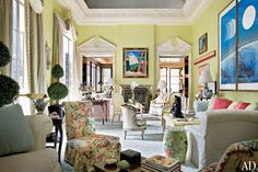 An investor and his wife enlisted Mario Buatta to create a colorful backdrop for their collection of modern and contemporary art and photography. Sherbet hues enliven the living room, shown, which features a commanding barrel-vaulted ceiling. (November 2009)
