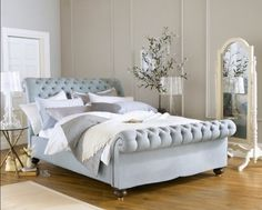 Stoffen chesterfield bed