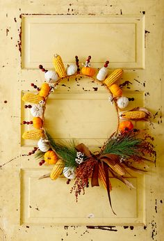 The base of this natural fall wreath is the snipped-off top of a wire tomato cage, which creates spokes that can spear a variety of seasonal vegetables, fruits, and berries. #falldecor #fallideas #wreathideas #fallwreath #wreath #bhg