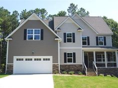The BARTON Plan in West Sanford Premier Community West Landing with a Community Pool. 4 Bedroom 3 Bath Foyer with Hardwoods Family Room with Gas Fireplace Master Suite wDual Vanities Large Walk in Closet Separate  Tub and Shower Large Open Kitchen with Pantry Granite Formal Living and Dining Rooms Guest Bedroom Downstairs Laundry Room Upstairs Large Loft Area Upstairs
