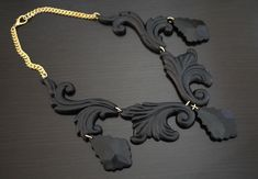 DIY Proenza Schouler necklace -  wooden decorative mouldings, plastic chandelier ornaments & spray paint