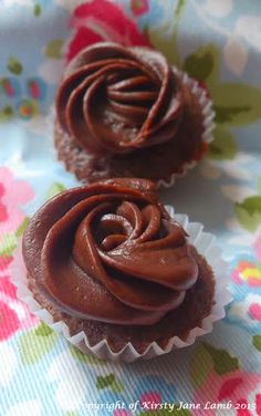 Mini chocolate truffle cupcakes with a chocolate ganache piped rose to decorate. A mini bite of heaven...x