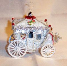 Sebnitz Carriage with wax baby, victorian scraps,Dresden trims. By Betsy Browning browning.designwerks@gmail.com