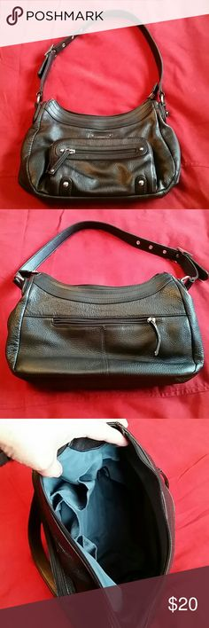 """LEATHER Stone and Co black bag Excellent used condition (looks totally new) high quality black leather bag by Stone and Co. One outer zip pocket on back, larger pocket with zip and second zip pocket on top in front. Lined in forest green material with three inner open pockets and one inner zipped pocket. Perfect condition from nonsmoking home. Has silver stud embellishments on front and lovely quality buckle on strap. Very well made bag!  Measures about 11"""" long by 8"""" high and 3 inches wide…"""