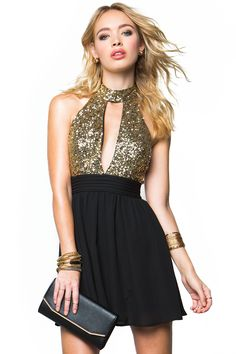 Catch a bit night fever in this disco-inspired flare dress, featuring a daring sequined bodice and a woven skirt. Halter neck. Plunging center front. cutout. Sleeveless. Open back with a button loop and concealed zip closure. Finished hem. $34.90