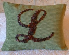 monogram button pillow...I did this using a bunch of old buttons collected over the years from shirts, sweaters, etc that I bought...came out cute!