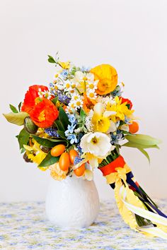 Annabella Charles, poppies, daffodils, yellow, orange, blue, bridal bouquet