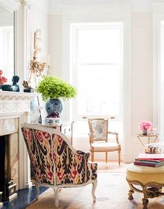 I love the mix of old and new as well as a touch of unexpected: mismatched chairs, and gorgeous Ikat fabric on one...
