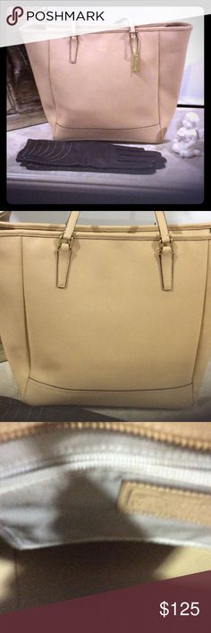 Large Coach tote Large (13x17) leather coach tote. Very roomy can hold I-pad and other items. Excellent condition no stain, marks or wear. A great neutral. Large zip compartment, phone pocket can hold iPhone 6 Plus and pocket for sunglasses. Coach Bags Totes