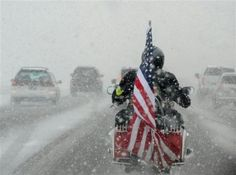 This is a Patriot Guard Rider. We will honor our fallen heroes, regardless the weather. They say if you don't ride in the rain, you don't ride. Well try this shit a few times...