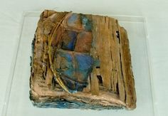 Inga Hunter | A Book of Signs - From My Invented World - The Imperium, handmade paper, paint, papyrus, wood, prints mostly wood or lino block. Pamphlet stitch binding.