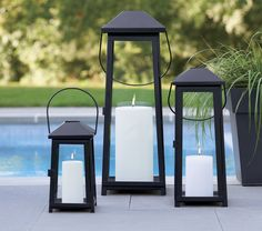 Statuesque Petaluma takes the classic paned glass lantern to new heights. Tall, rectangular frame rises to a simple silhouette black iron to let the light shine indoors or out. Three sizes at a great price triple the impact of this modern classic.