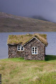 Stone house, sod roof. Sandoy, Faroe Islands
