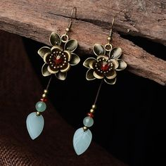 Lucky Brand Antiqued Gold Tone Red Stone Peacock Feather Drop Earrings
