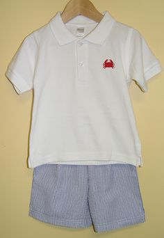 Seersucker + polo = classic beach wear! Our classic polo with a crab embroidery and navy seersucker shorts make this set perfect for your next vacation. Was: $50 Now: $26 (includes embroidery & shipping). Boys sizes: 12m, 18m, 2, 4 & 6.