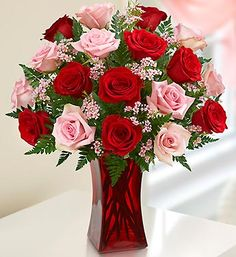 Shades of Pink and Red™ Premium Long Stem Roses- long-stem pink and red #roses, accented by fresh waxflower and salal in a stylish red glass gathering vase $64.99- $89.99