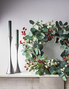 This traditional yet festive wreath is green studded with white and red berries to give a Christmas welcome on your door.