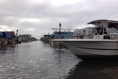 """Boats float along Woodcleft Avenue (a.k.a.""""The Nautical Mile"""") in Freeport, L.I. brought in Monday night by the swirling waters of superstorm Sandy."""