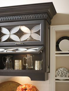 Beautiful Kemper cabinetry featuring the stunning Ellington art glass door