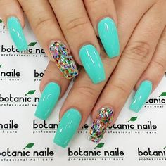 Sea green is a great color which is soothing and calm for the eyes and it could totally rock a coffin nail look alone. But you can level it up with a rhinestone nail polish for added color and life.