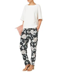 New In: Clothing | Black Rose Floral Printed Trousers | Phase Eight > This lightweight crepe printed trouser is ideal for the summer season, for ultimate comfort this style features an elasticated drawstring with front pockets and faux pockets at the back.