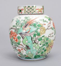 A WUCAI JAR AND COVER, Period Of KangXi. The jar is of wide globular-shaped and the exterior is decorated with a bird, many insects surrounded by flower blossoms. On the base of the jar there is a Sotheby's tag. 7 3/16 in. tall.