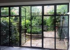 crittall doors and courtyard garden Crittal Doors, Crittall Windows, Steel Doors And Windows, Casa Patio, Garden Doors, House Extensions, Interior Barn Doors, Architecture, Pergola