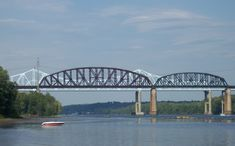 The Castleton Bridge and Alfred H. Smith Memorial Bridge, as seen from the west bank of the river, south of the bridges and directly across the Hudson River from the Schodack Island State Park. Castleton Bridge is the green bridge in the background.