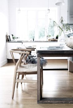 Wishbone chairs in the beautiful home of Swedish interior stylist Pella Hedeby.