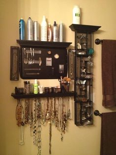Hair products, make-up, and jewelry wall for bathroom. Materials: black shelves(menards), wire mesh desk organizers (meijer), cookie sheet, black spray paint, drywall anchors, and screws, screw hooks for necklaces.