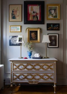 A gallery wall above an ornate dresser in the New York apartment of Adam Charlap Hyman