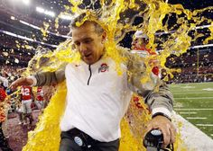 Ohio State head coach Urban Meyer is dunked with Gatorade during the NCAA college football playoff championship game against Oregon on Jan. 12, 2015, in Arlington, Texas.