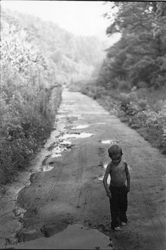 William Gale Gedney - Small Boy on Muddy Dirt Road, Kentucky, USA  1964. S)