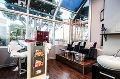 A nail bar and platform pedicure area create an intimate nail studio in the salon.