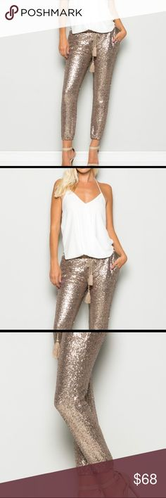 One left Host PickROSE GOLD SEQUIN JOGGERS GORGEOUS PALE ROSE GOLD SEQUIN JOGGER PANT FULLY JERSY LINED WITH POCKETS FOR COMFORT AND A SOFT WAISTBAND WITH A TASSLE TIE if bundled, please create through meThanksmeasurements will Be put up soon. boutique Pants