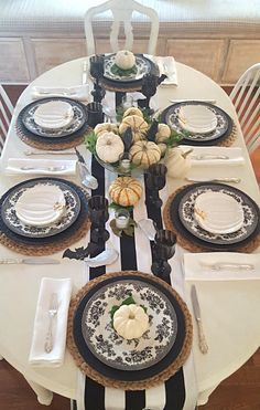 I was inspired by nature for my HALLOWEEN table, so spooky birds, white pumpkins and a little greenery set the tone for this tablescape.